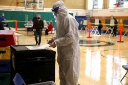 Tom Holoubek-Sebok casts his vote at Coleytown Elementary School (Westport, CT) in the early afternoon. Nov. 3, 2020, by Jarret Liotta