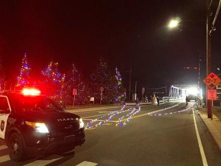 Crari Memorial Bridge is closed as Al's Angers volunteers and AJ Penna Construction string Christmas lights, Westport, CT, November 20-21, 2020 by Jaime Bairaktaris