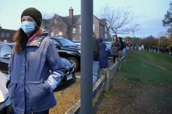 Suzanne Hermus, Westport CT, waiting to vote at Greens Farms Elementary, Nov. 3, 2020, by Jarret Liotta