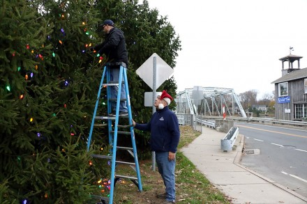 Al's Angels found Al DiGuido and volunteer Bob Caporale hanging Christmas light, Bridge Square, Westport, CT, Nov. 21, 2020, by Dave Matlow