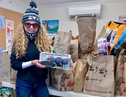 Mary Sansolo, author of What Up Westport blog, with bounty from a food drive at Assumption Church, Oct. 31, 2020, by Lynn Miller
